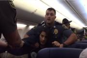 بالفيديو ... شرطة أمريكا تطرد مسلمة حامل من طائرة لأجل كلبين