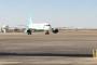 بالصور.. هبوط أول طائرة سعودية بمطار بغداد منذ 27 عاما