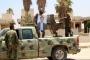 معارضو الأسد يسلمون سلاحهم بمهد الثورة السورية