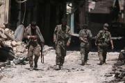 أكراد سوريا ينشدون حماية الأسد بعد أن خذلتهم واشنطن