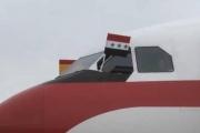 طائرة ملك إسبانيا تحط في العراق رافعة 'علم نظام البعث'