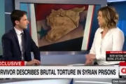 بالفيديو ... معتقل سوري سابق يتحدى مرشحة الرئاسة الأمريكية 'الأسد مجرم'