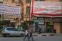 ميدل ايست آي: الشرطة المصرية تجبر أصحاب المحلات على تعليق لافتات دعماً للتعديلات الدستورية