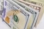 الدولار يتراجع عالمياً بالتزامن مع تحقيقه مكاسب أسبوعية