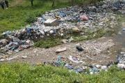 حومين الفوقا ترفد نهر الزهراني بأطنان من النفايات