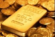 الذهب ينزل مع دعم التجارة للدولار